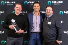 Bremtel Directors Andre (left) and Grant (right) pictured with Carlisle Homes Director John (centre) with the award